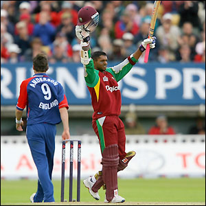 Chanderpaul raises his bat on completion of his century