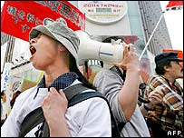 People shout slogans during a demonstration on a street in downtown Tokyo, 03 May 2007 to mark the 60th anniversary of Japan's constitution