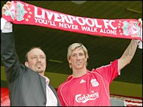 New Liverpool striker Fernando Torres with boss Rafa Benitez