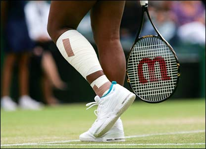 Strapping on Serena Williams's left leg