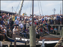 Crowd on dockside (BBC)