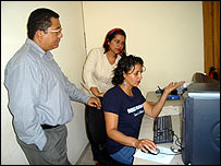 Dina Meza (seated) at work in her office in Tegucigalpa (image: Amnesty International)