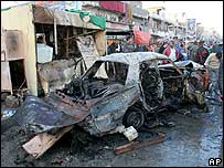 A car destroyed in a suicide bomb blast in the Shia district of Sadr City