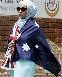 A Muslim worshipper arrives at a mosque in Sydney draped in the Australian flag on 3/11/06