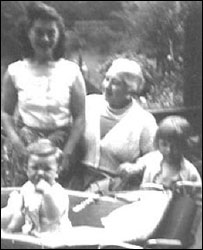 Jono in pram, with mother Sylvia, grandmother Ginny and sister Sharon