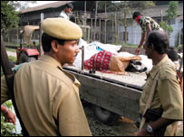 A villager wounded in the attack being taken to the hospital in Assam village