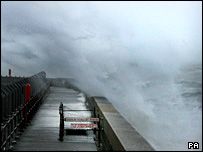 Waves crash up the sea wall at Dover