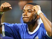 Robinho celebrates scoring for Brazil