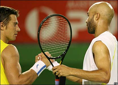 Alex Kuznetsov and James Blake shake hands after the match