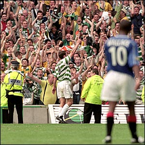 Chris Sutton (centre) celebrates scoring for Celtic against Rangers