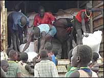 People in Karamoja unload food sacks from the UN