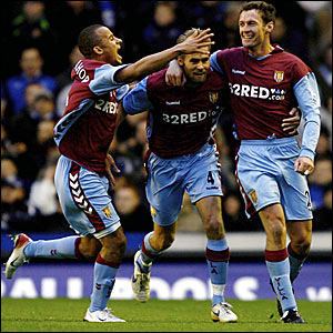 Chris Sutton (right) is congratulated after scoring his only goal for Aston Villa in the 1-0 win over Everton
