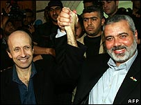 Alan Johnston, hand held aloft by ousted Hamas PM Ismail Haniya