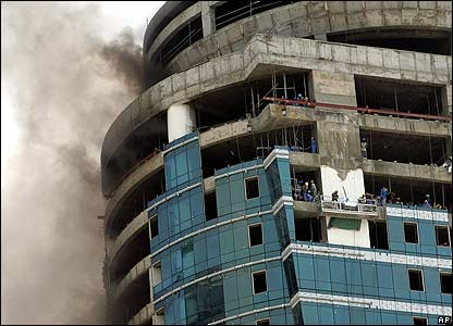 Smoke pours from a high-rise building under construction in Dubai