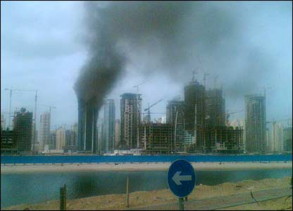 Smoke pours from a high-rise building under construction in Dubai (Image: Kamran Hussain)