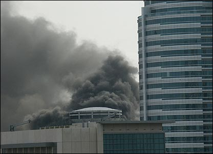 Smoke pours from a high-rise building under construction in Dubai (Image: David Balloch)