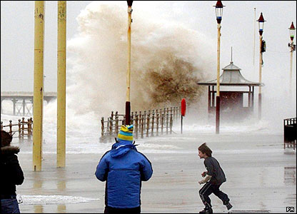 People and waves on the promenade in Blackpool