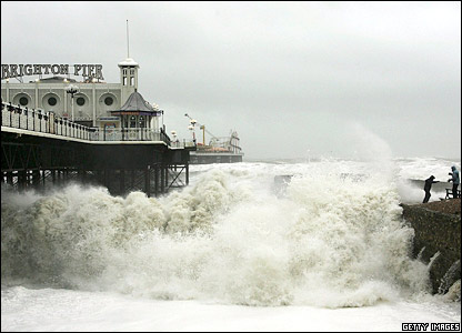 Waves crash up on to the seafront in Brighton
