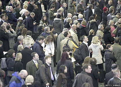 Passengers waiting for news of delayed trains at Euston station