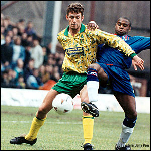 Chris Sutton in action for Norwich against Chelsea