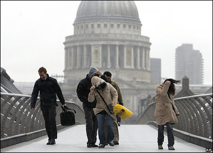 People struggle across Millennium Bridge in the centre of the capital