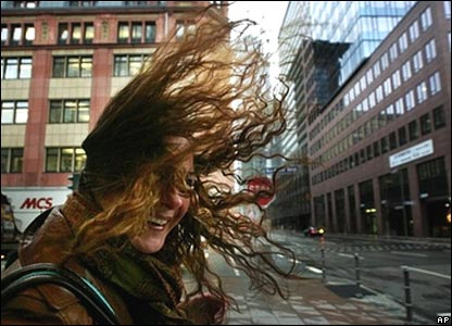 A woman's hair is lifted by strong winds in Frankfurt, Germany
