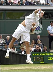 Juan Carlos Ferrero serves to Roger Federer