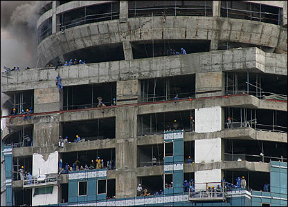 Workers climbing down
