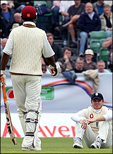 Ian Bell (right) reacts after dropping Shivnarine Chanderpaul