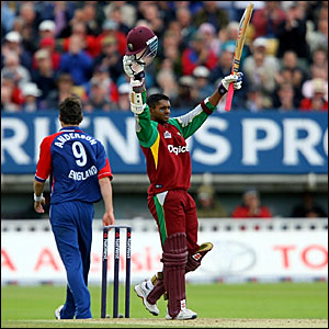 Shivnarine Chanderpaul celebrates scoring his third century of the summer