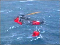 Rescue helicopter and MSC Napoli lifeboat