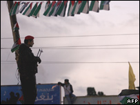 A Palestinian security guard stands on a rooftop during a Fatah rally in Gaza City (Dec 2006)