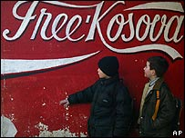 Kosovo Albanian children next to Free Kosovo slogan in Mitrovica