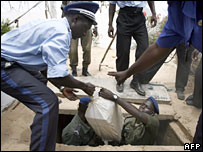 Police officers removing bags of cocaine from a villa in Senegal