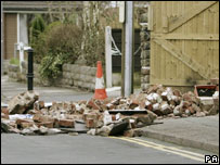 A woman died after a wall collapsed in Fern Close, Stockport