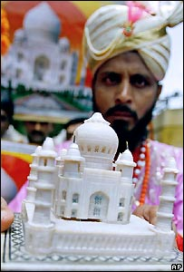 Indian man with a miniature taj