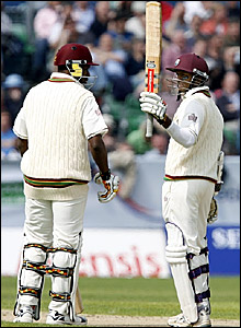 Shivnarine Chanderpaul (right) celebrates passing 7,000 Test runs