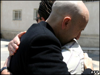 Alan Johnston (left) hugs a Palestinian colleague