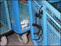 Cages with handcuffs still attached (Picture from Kent Police)