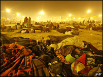 Hindu devotees sleep in the open, on the banks of the River Ganges, while waiting to take a holy dip on Friday
