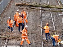 Workmen clear fallen tree from track near Sutton Coldfield