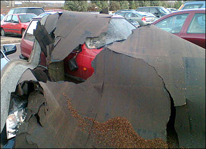 Roof fallen onto parked cars