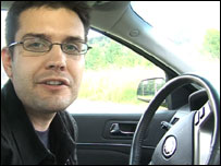 Iain Mackenzie inside communicating car