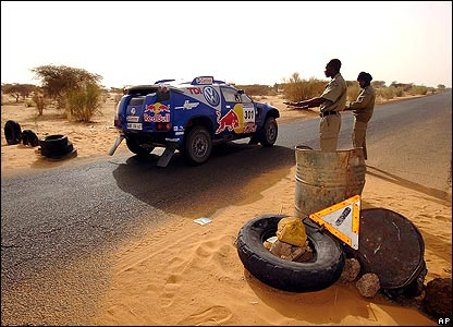 Giniel de Villiers is directed by policemen during the 11th stage of the Dakar Rally in Mauritania