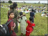 Ethnic Tamil refugees fleeing from eastern Batticaloa arrive 210km north-east of Colombo