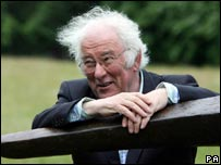 Seamus Heaney posing by field gate