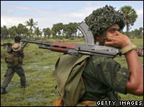 Sri Lankan government soldiers patrol through the countryside near Kalkudah in north-eastern Sri Lanka