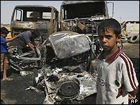 Boy in front of scene of bombing