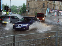 Cars driving through floodwater in Cathcart. Pic by Alan Rhodes