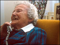 A female pensioner on the phone